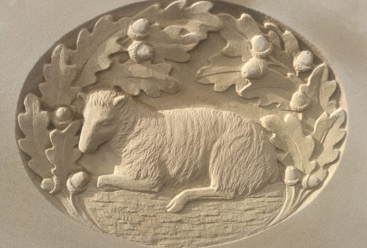 lamb and oak wreath carving